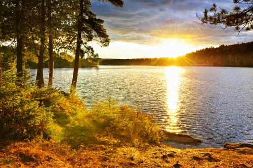 A guide to how to plan your first car camping trip with a mountain lake at sunset.