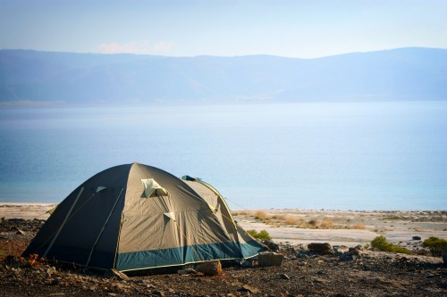 Guide to how to plan your first car camping trip with a tent by a mountain lake