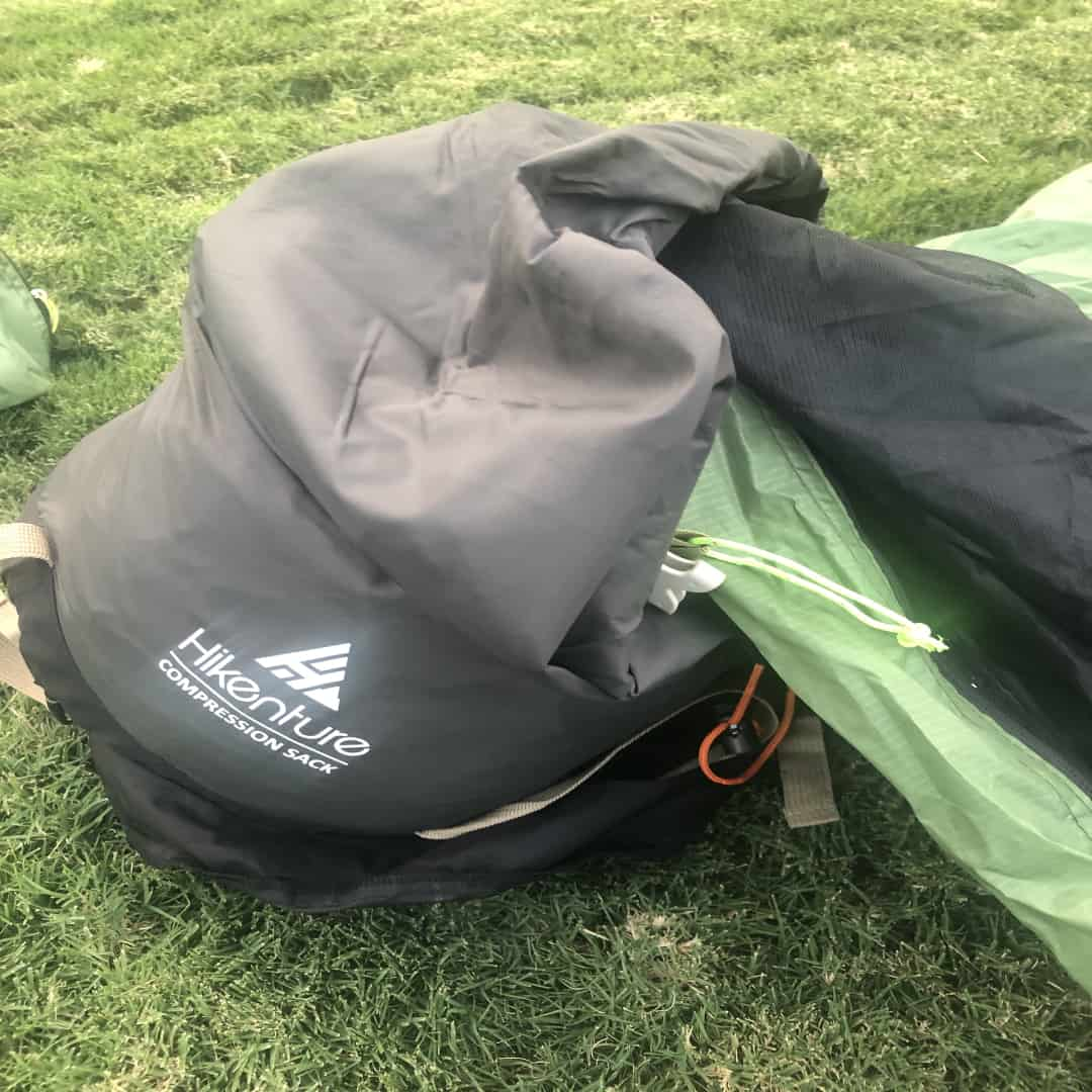 Showing how to put your tent back into a stuff sack after a camping trip.