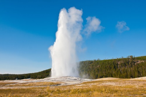 Visit Yellowstone National Park and see geysers like Old Faithful