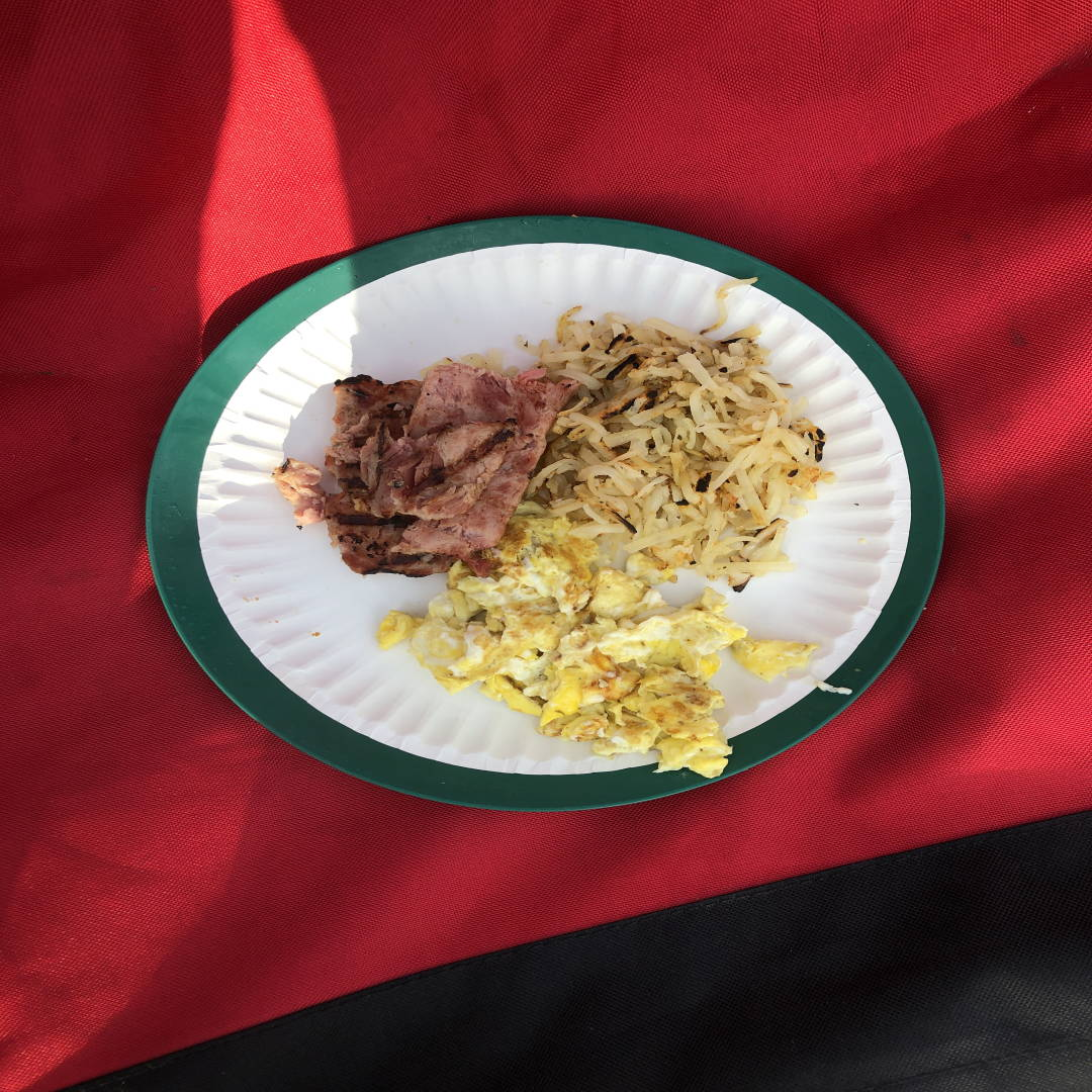 Photograph of my camping breakfast of scrambled eggs and ham.